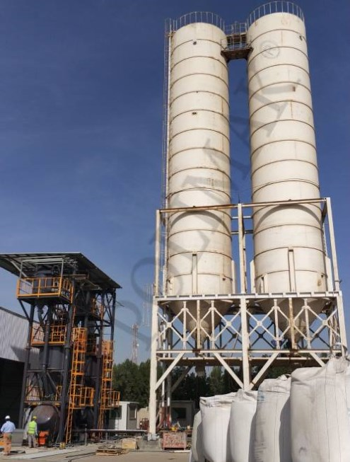 Cement silo filling by big bag discharging and pneumatic conveying system