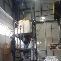 Big bag unloader weighing dosing system