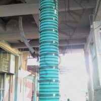 Telescopic spout and loading chute for open bulk truck