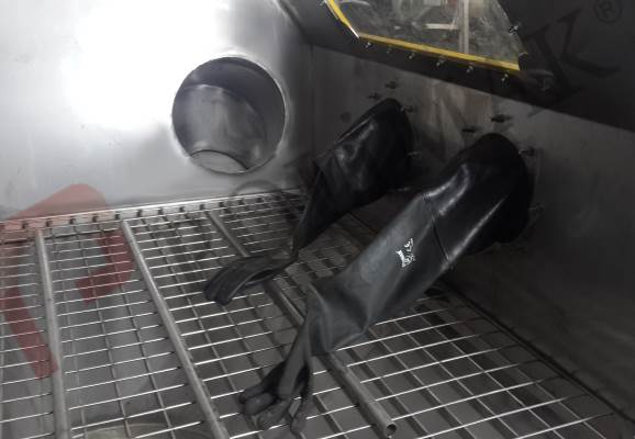 Sack tipping station safety gloves
