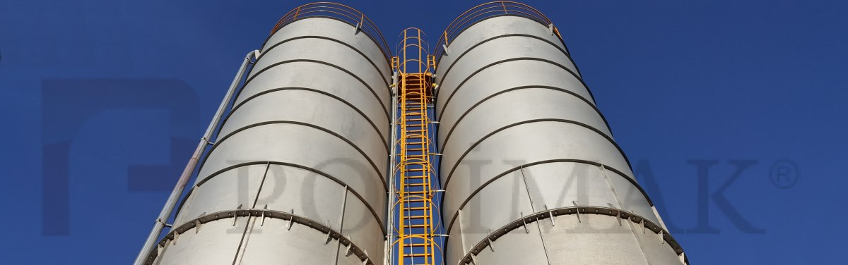 Stainless steel bulk material storage silos with ladder and pneumatic conveying pipeline