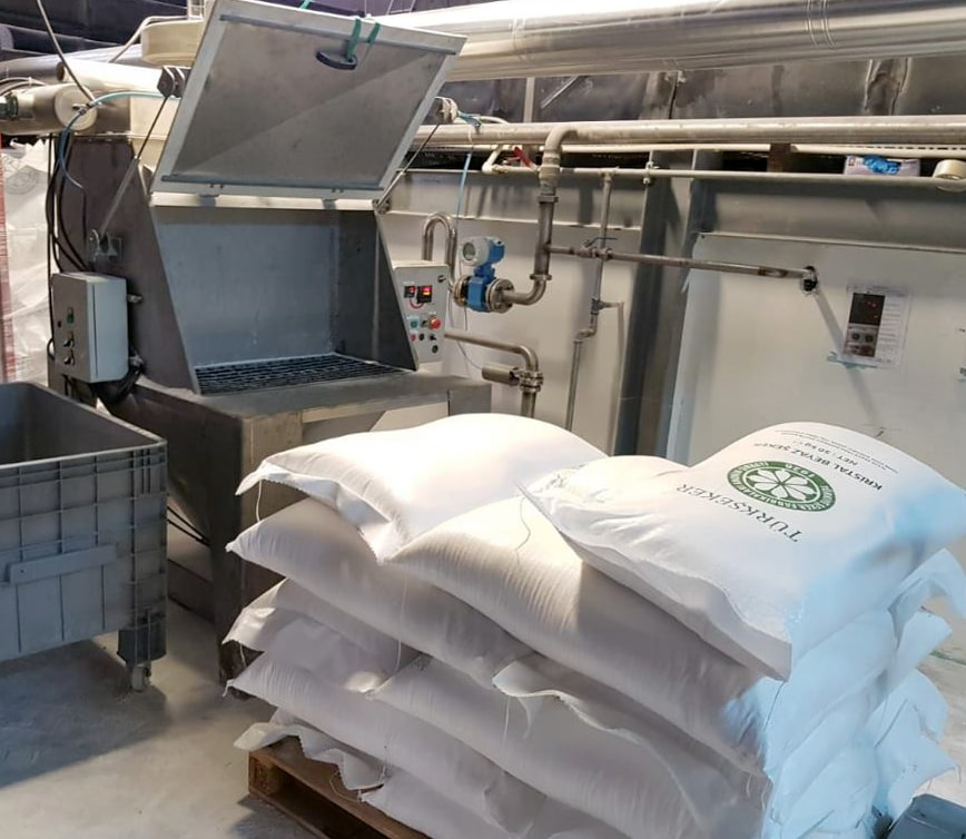 bag dump and sack discharge system